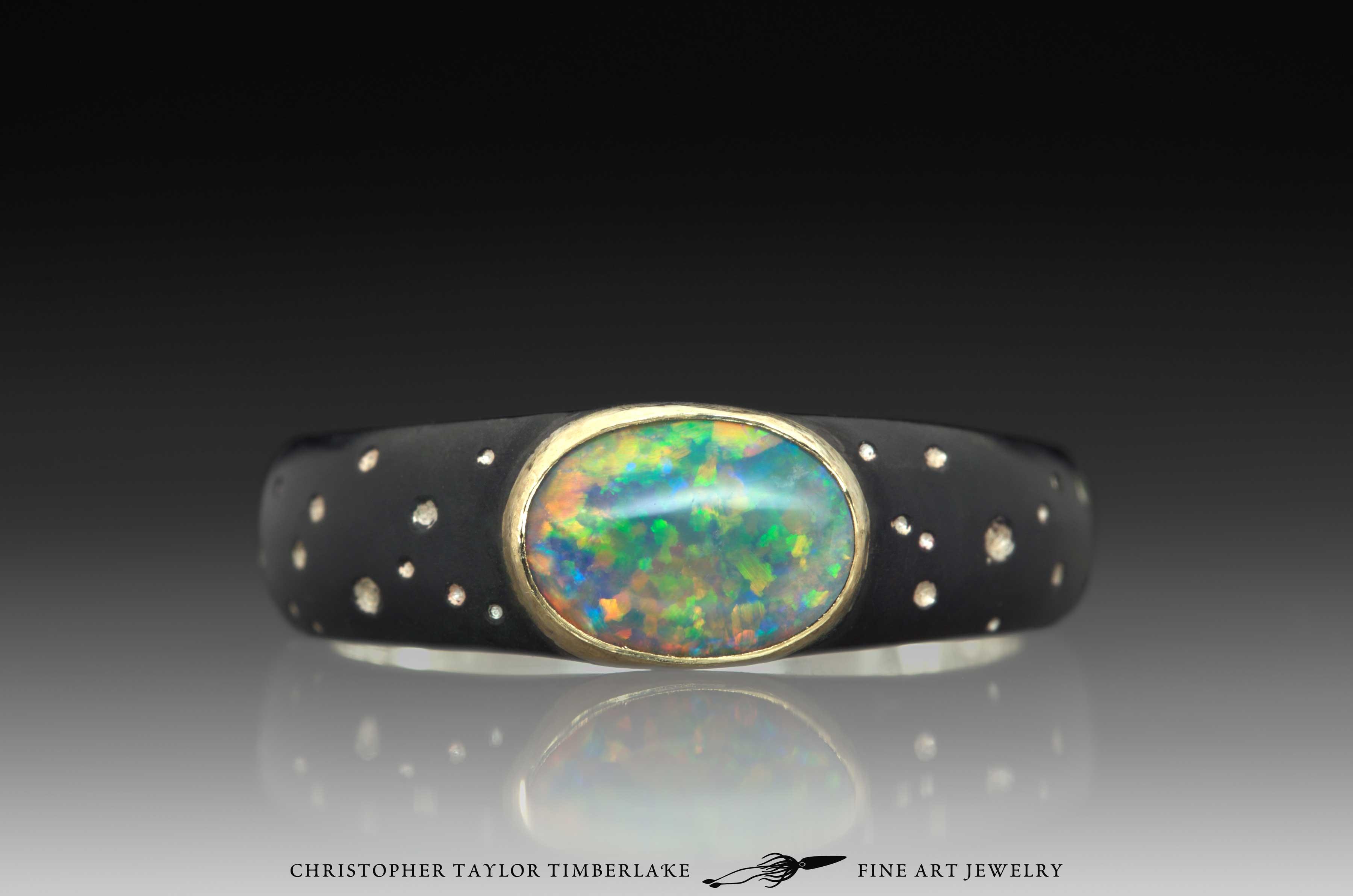 Hubble-Star-Pattern-Oval-Opal-Ring,-18K-karat-yellow-gold-bezel,-blackened-sterling-silver-1