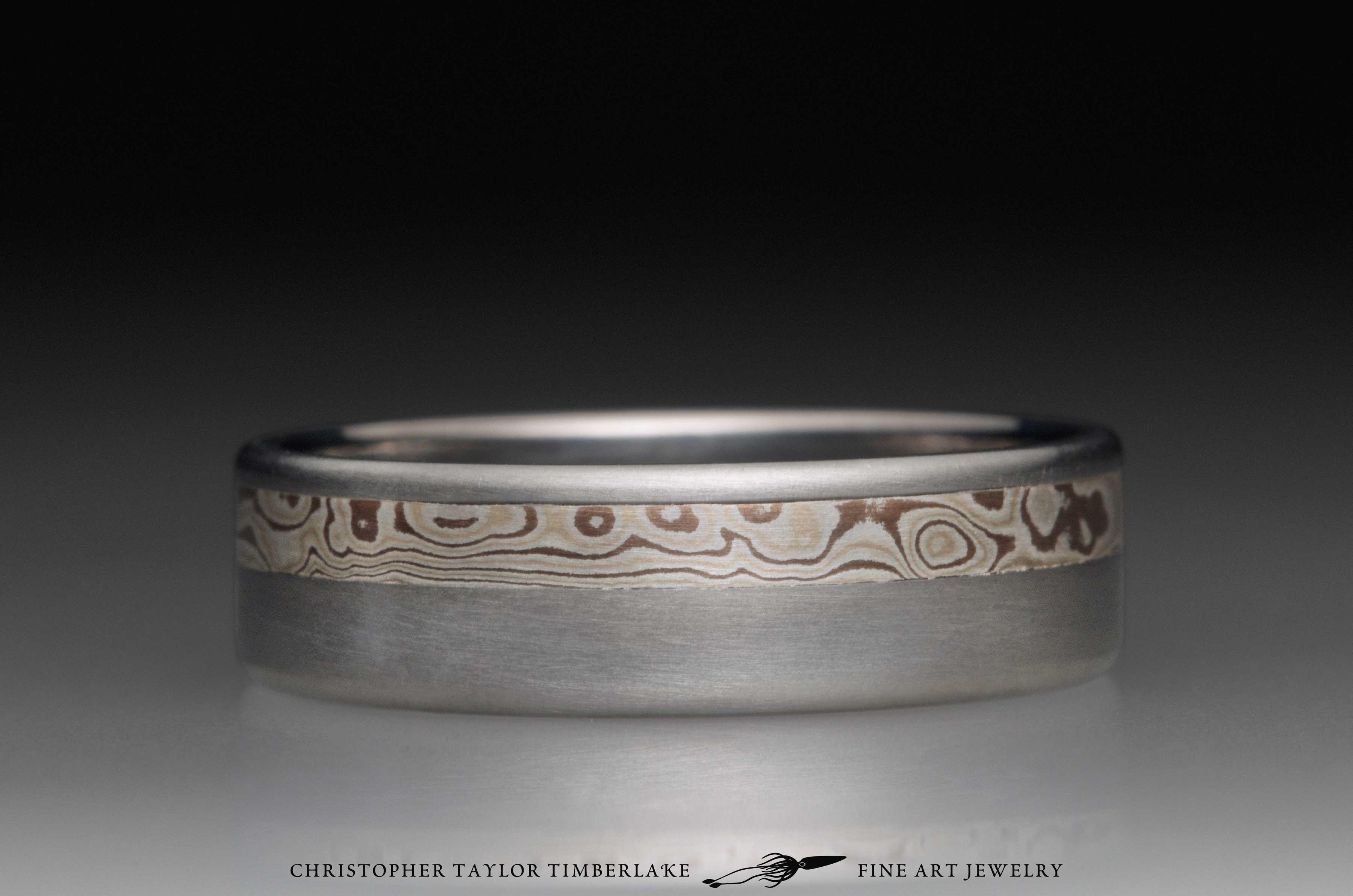 Mokume gane sterling silver, shakudo, and kogane inlay channel in titanium, 6.5mm (3.25-2.25-1) 1