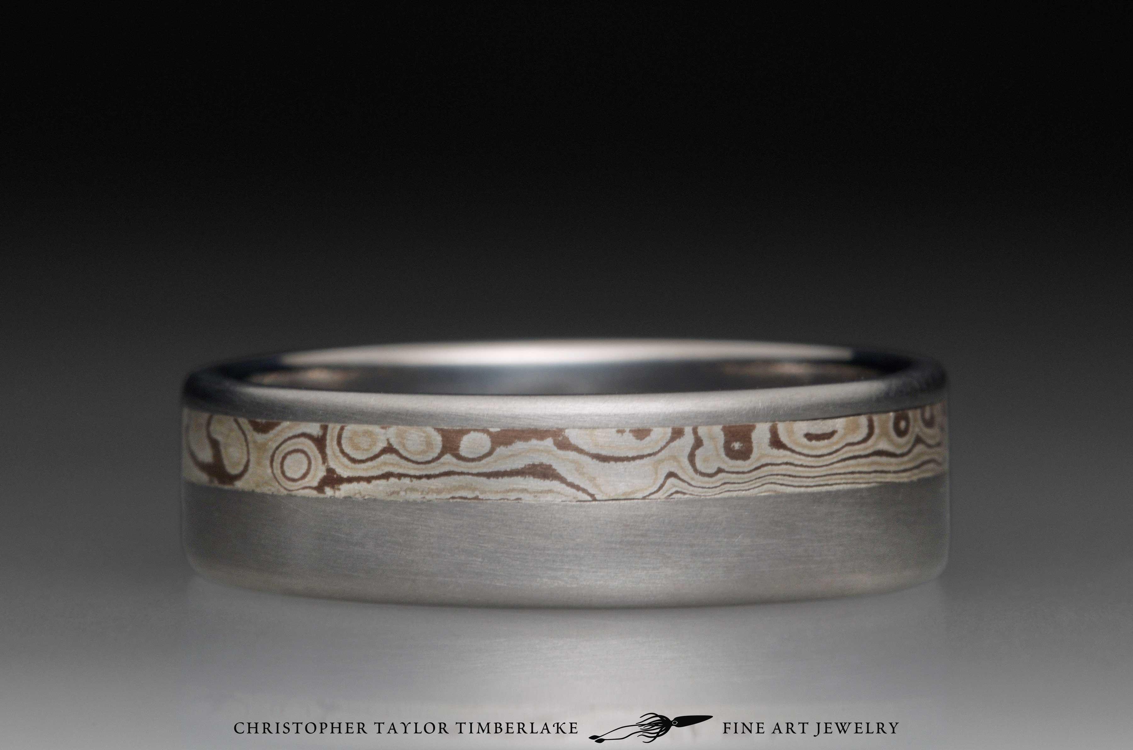 Mokume gane sterling silver, shakudo, and kogane inlay channel in titanium, 6.5mm (3.25-2.25-1) 2